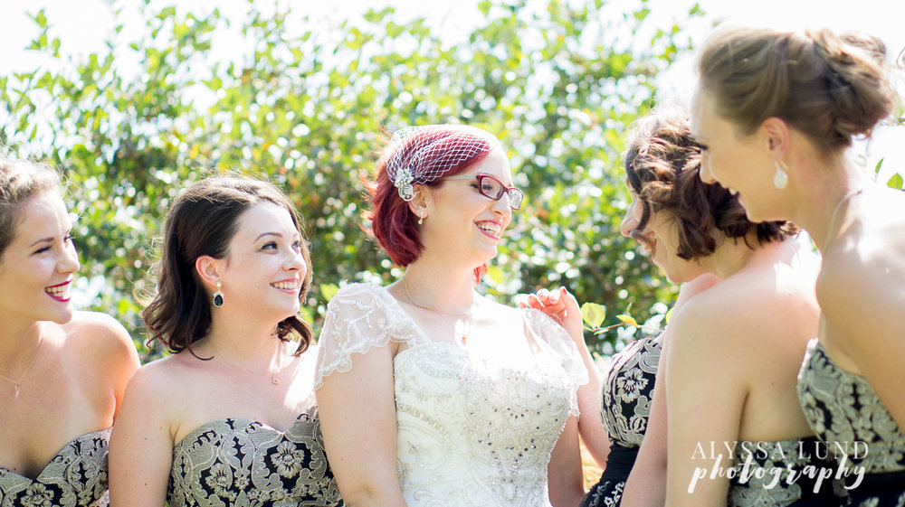Bride and Bridesmaids in a sunny park