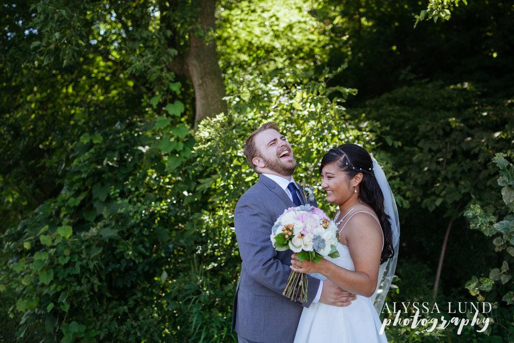 Outdoor Minnesota Wedding laughing couple portrait