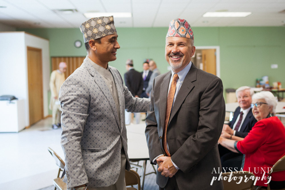 Minneapolis Hindu Wedding uncle sharing Nepali hats