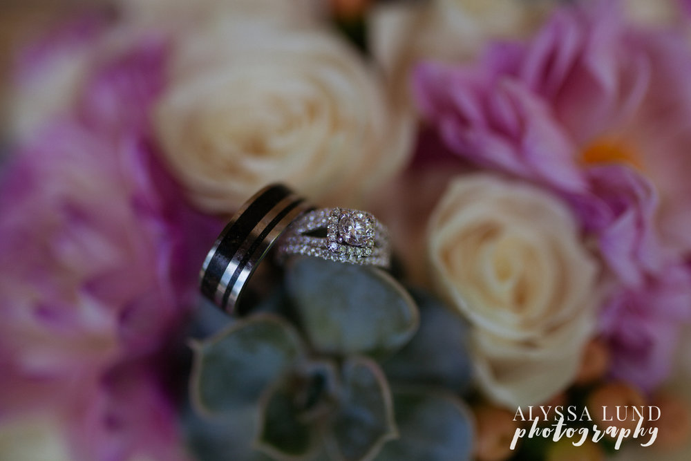 Rings and wedding bouquet with succulents