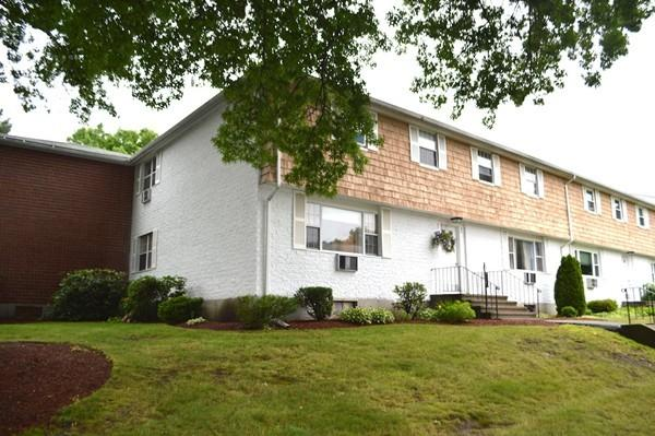 40 Kingston St. #40 North Andover - This beautiful end unit offers a sunny, spacious feeling open concept, big kitchen, wall of cabinetry with built in desk area, updated counters and appliances! $299,000