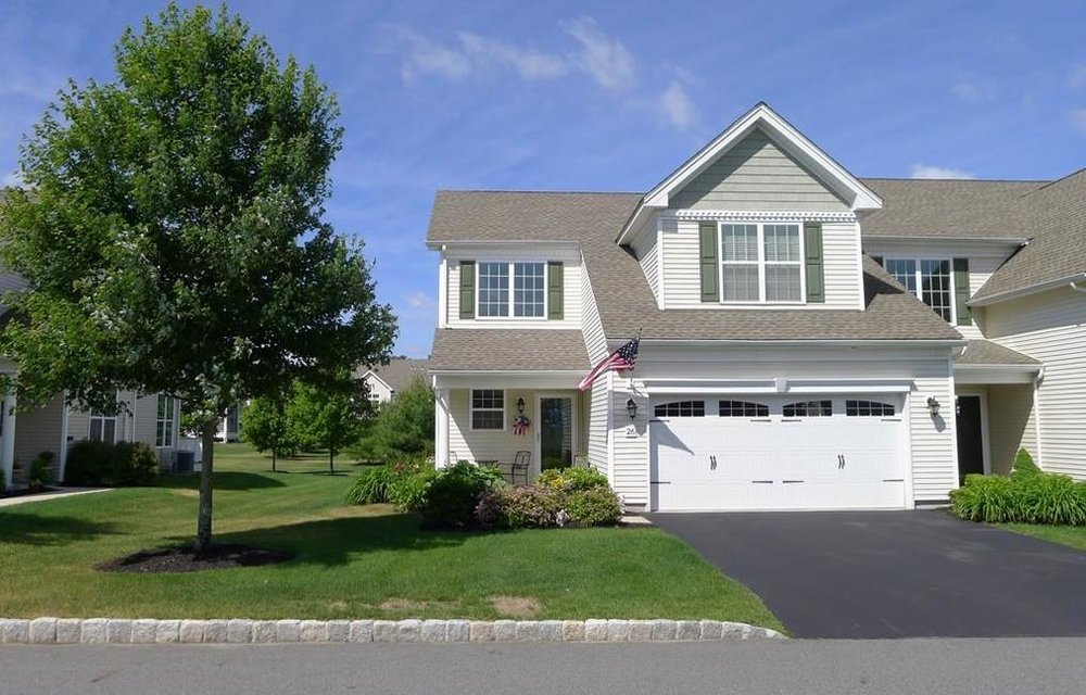 26 Herrick Dr. #57 Methuen - Located in the 'Regency at Methuen', and over 55 community this unit has an open floor plan and a combination living room & dining room with soaring ceilings & access to the back yard. $474,850