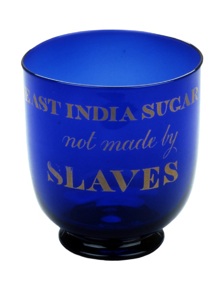 """Blue glass sugar bowl inscribed in gilt 'EAST INDIA SUGAR/not made by/SLAVES'"". ca. 1820-1830. Bristol. Height: 110 mm; Diameter: 100 mm. British Museum Department of Britain, Europe, and Prehistory. 2002,0904.1."