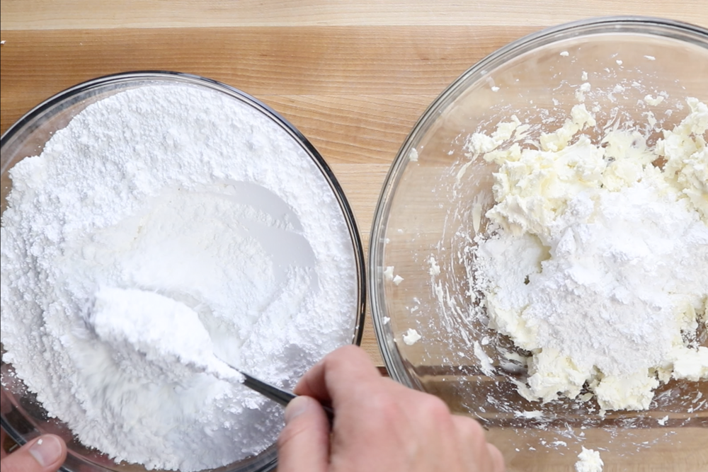 3. Add powdered sugar a few spoonfuls at a time mixing in between. -