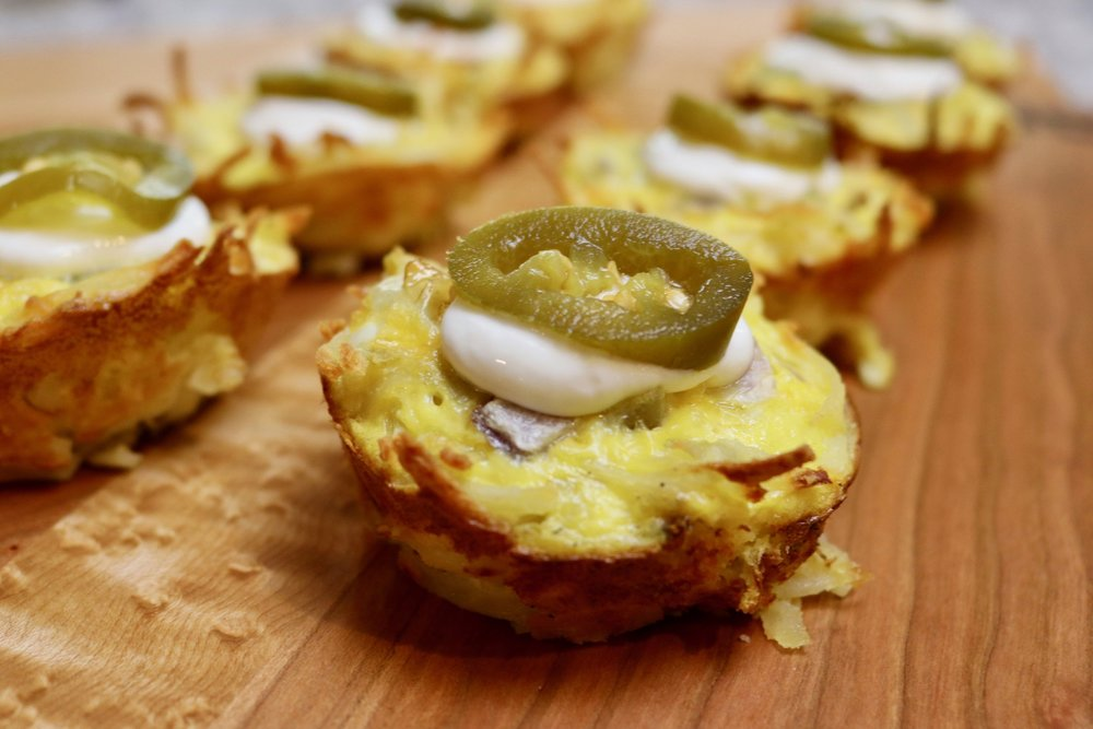 6. Allow muffins to cool in muffin tins about 5 minutes before moving.  Top with sour cream and jalapeño. (optional) -