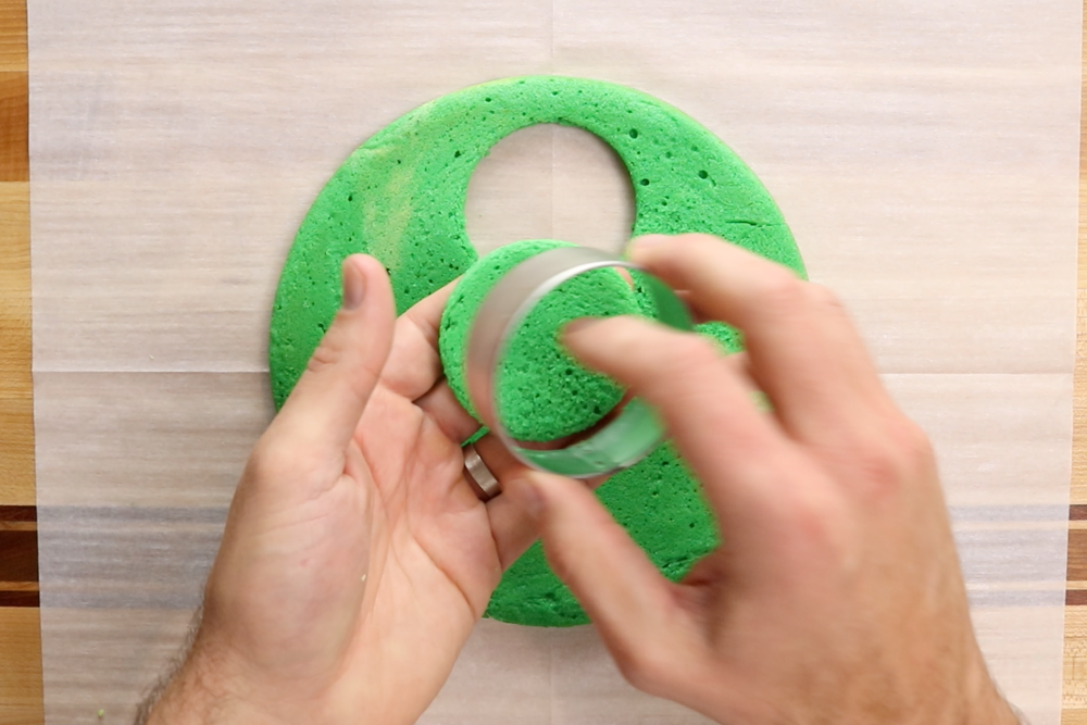 Use a round cookie cutter to cut circles of cake from each layer. -