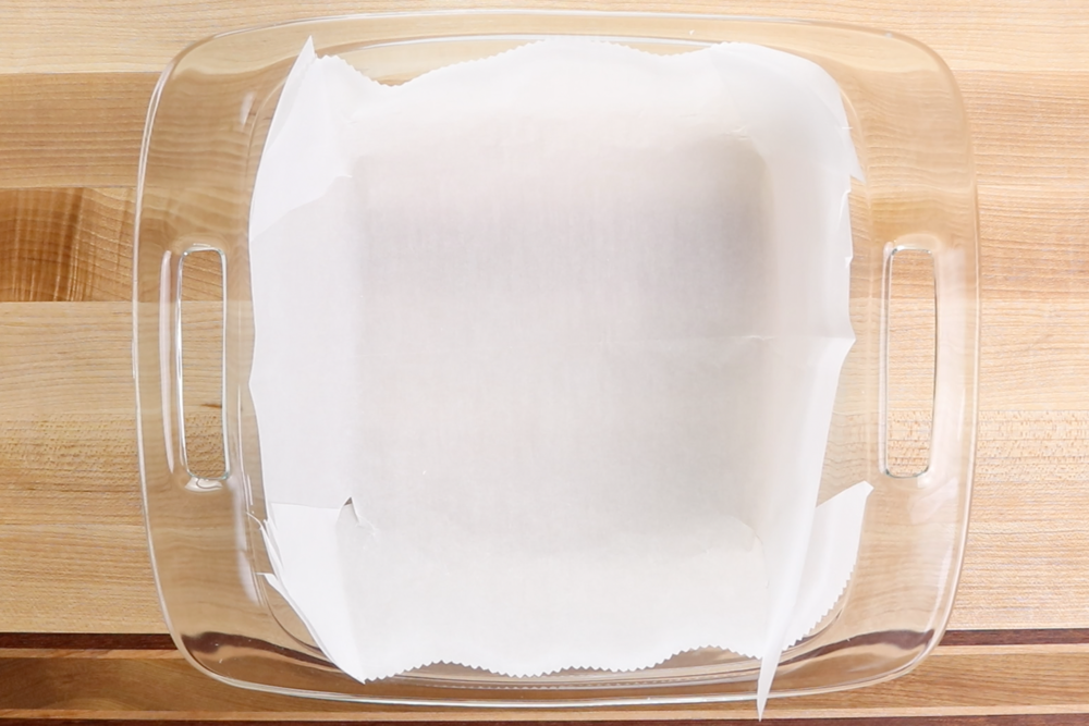 1. Line an 8 x 8 baking dish with parchment paper. Set aside. -