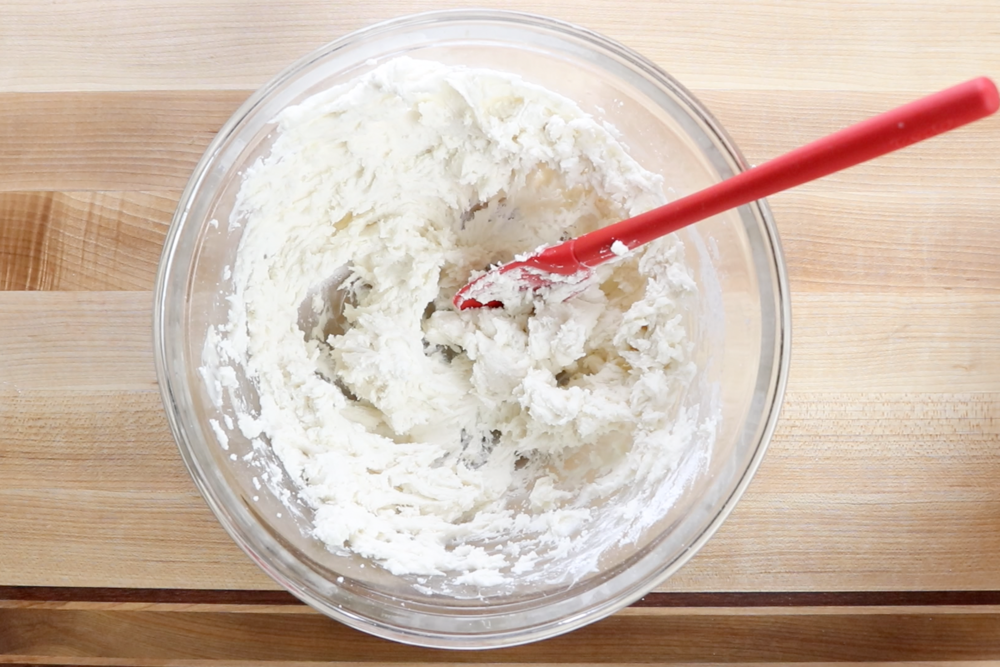 3.Add the rest of the powdered sugar and water, beating until smooth.The mixture will be stiff, but should be flexible enough to sandwich between your cookies. -