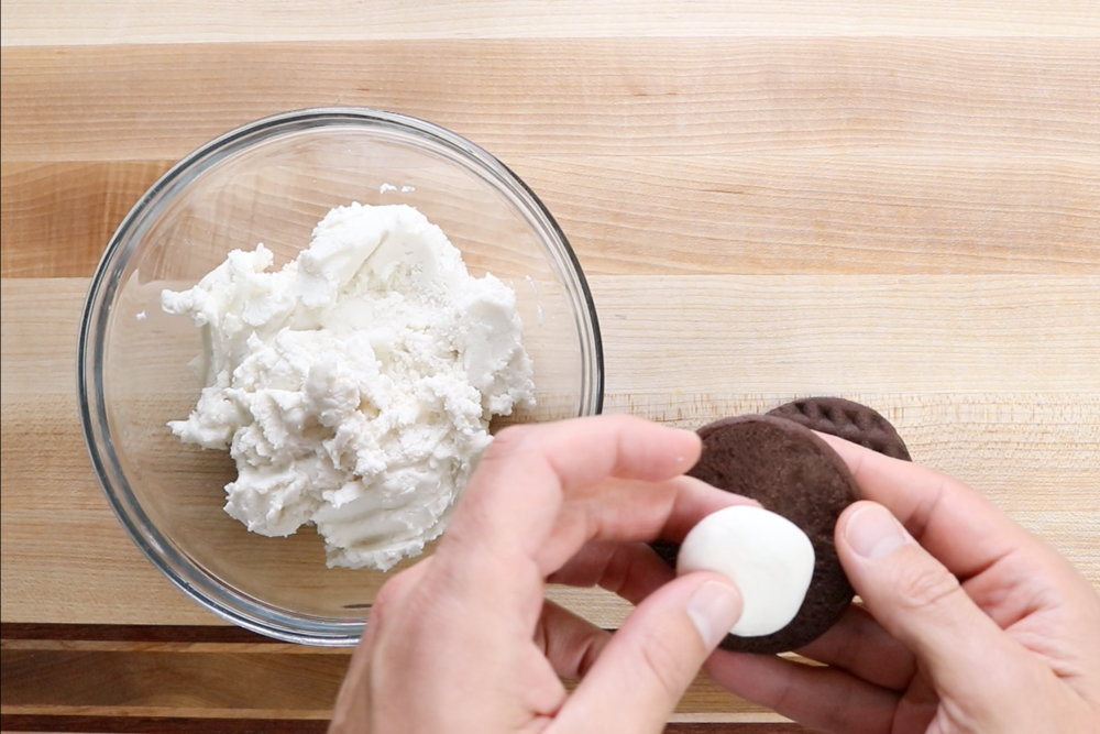 1.Roll a ball of filling between your hands and place on the bottom of one of the cookies. -