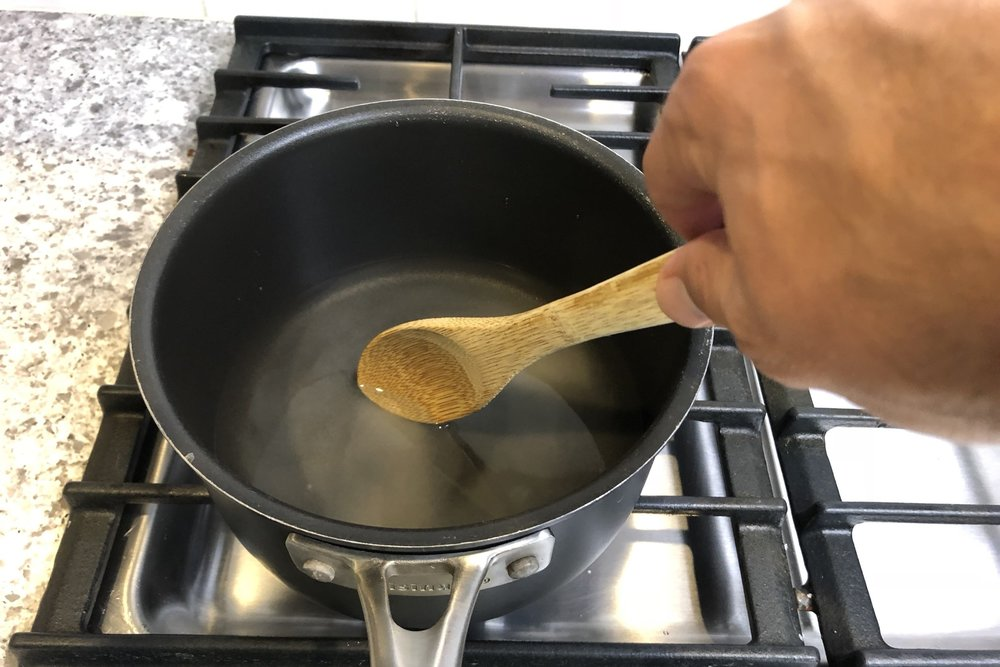 3.  In a medium-sized saucepan, combine the sugar and water until dissolved.  Bring the mixture to a boil over medium heat. -