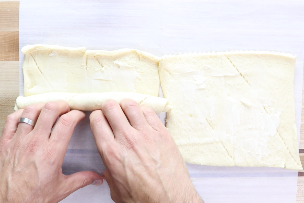 4.  Roll each rectangle into a tight roll using the longer side of the rectangle.   -