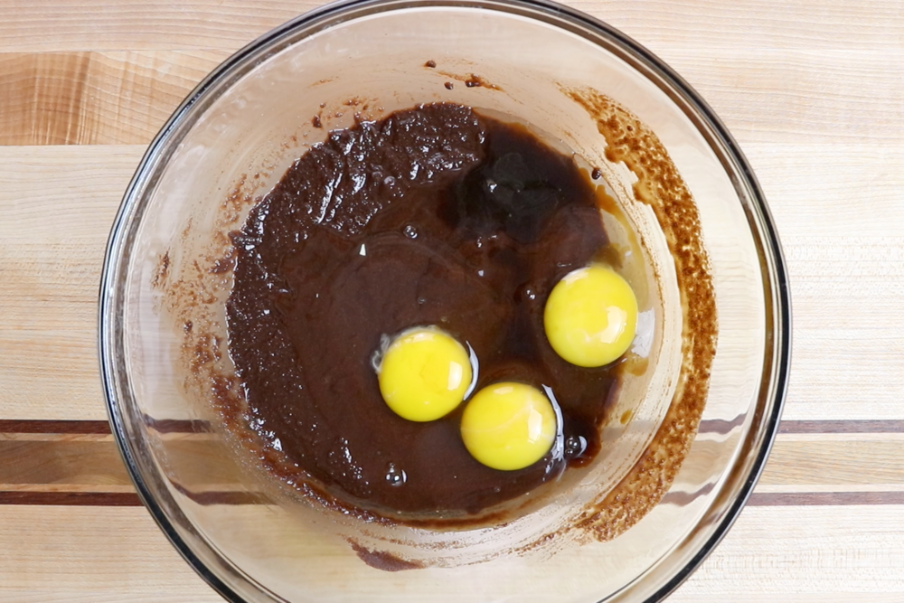7. Whisk in the eggs and vanilla until just mixed. -