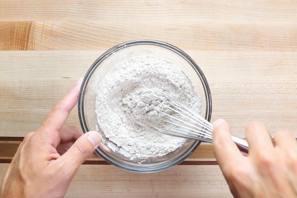2. In a medium bowl combine flour, pumpkin pie spice, baking powder and salt. Set aside. -