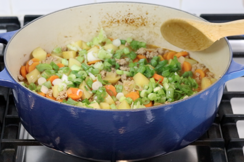 7. Then add green onion. Stir gently. -