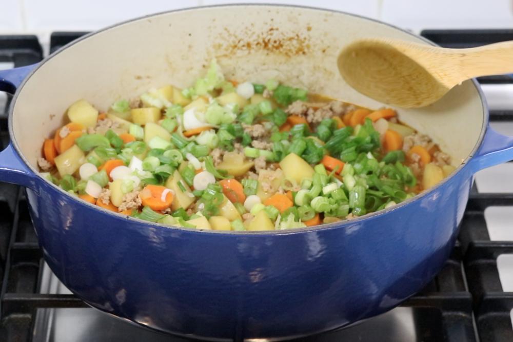 7. Then add green onion. Stir gently. -