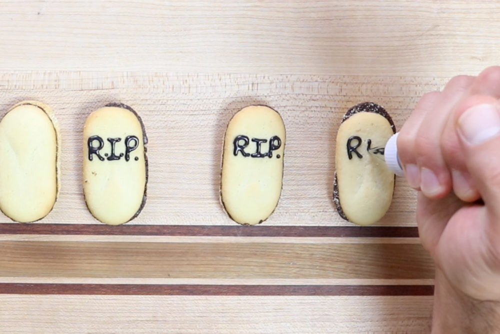 10. Prepare Milano cookies buy using black icing to write on the tombstones. -