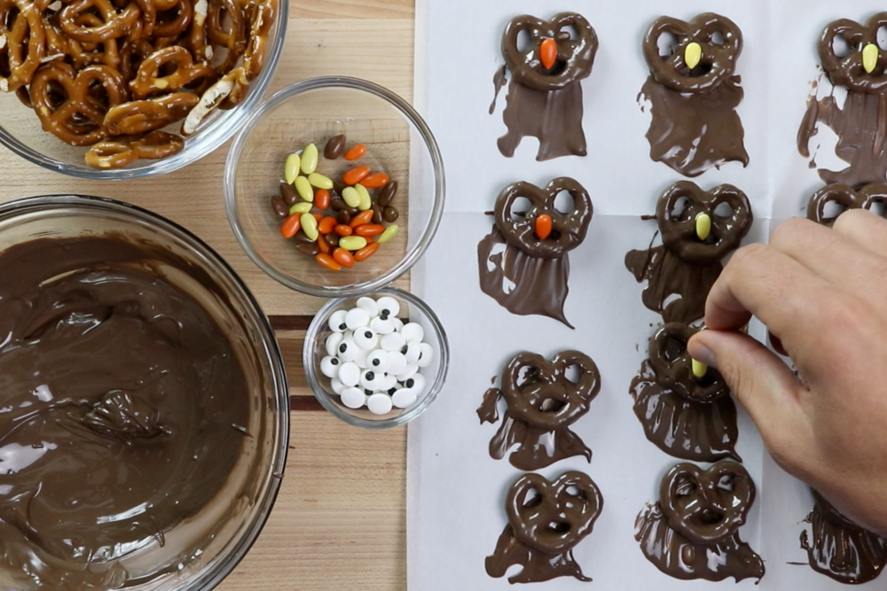 6. Add an orange or yellow candy in the middle of the pretzel for the nose. -