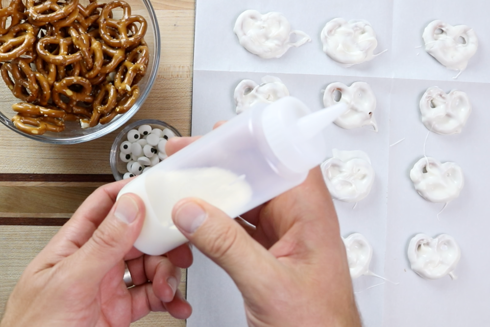 5. Transfer remaining white chocolate to a squeeze bottle or pastry bag. -