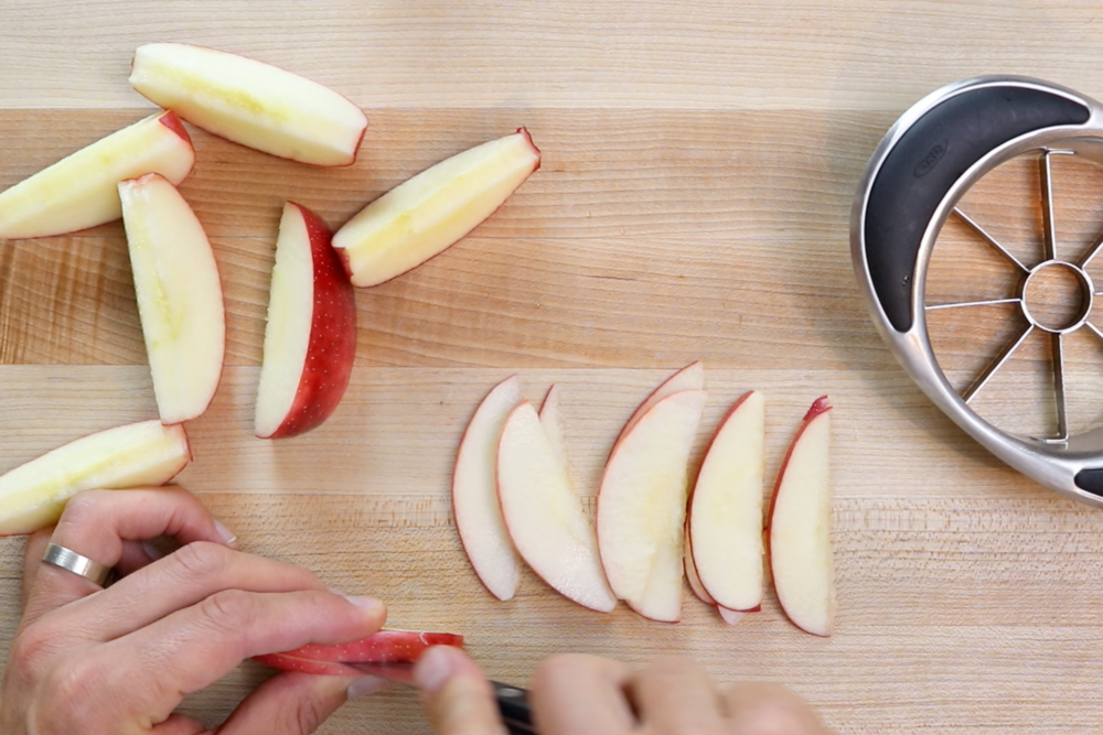 2. Core the apples with an apple corer or with a sharp paring knife. Cut the apples in paper-thin slices. -