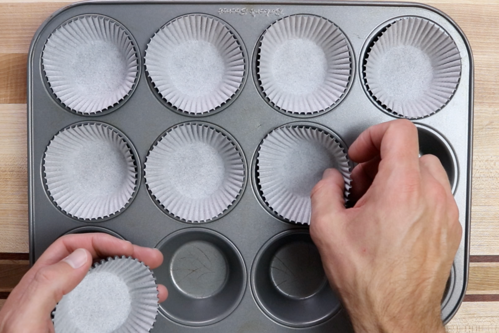 1. Preheat the oven to 350 degrees and line a 12-cup muffin tin with baking cups. -