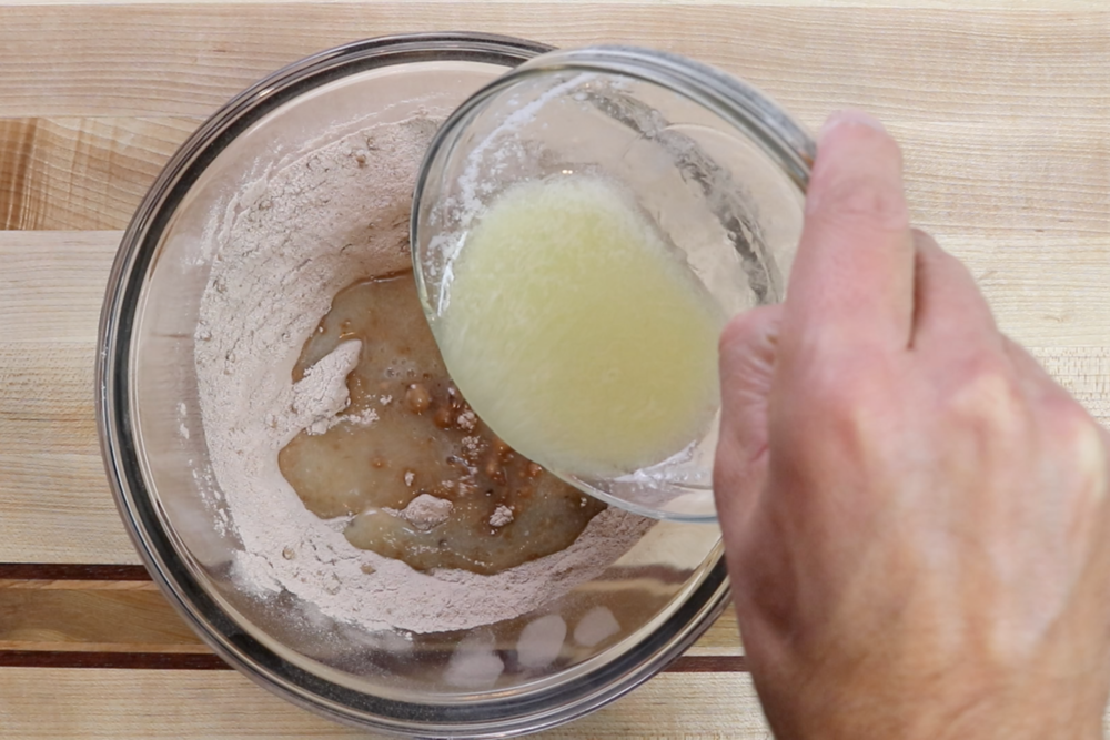 4. Add the melted butter mixture and whisk until smooth. -