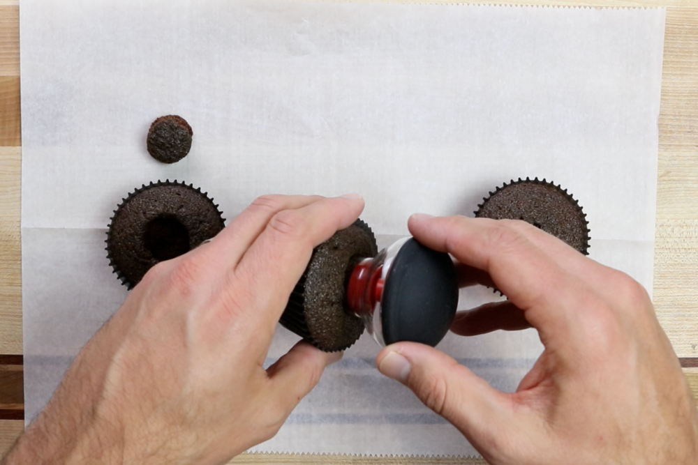 1. Using a cupcake corer, remove the insides of the cupcakes. Save the pieces. -