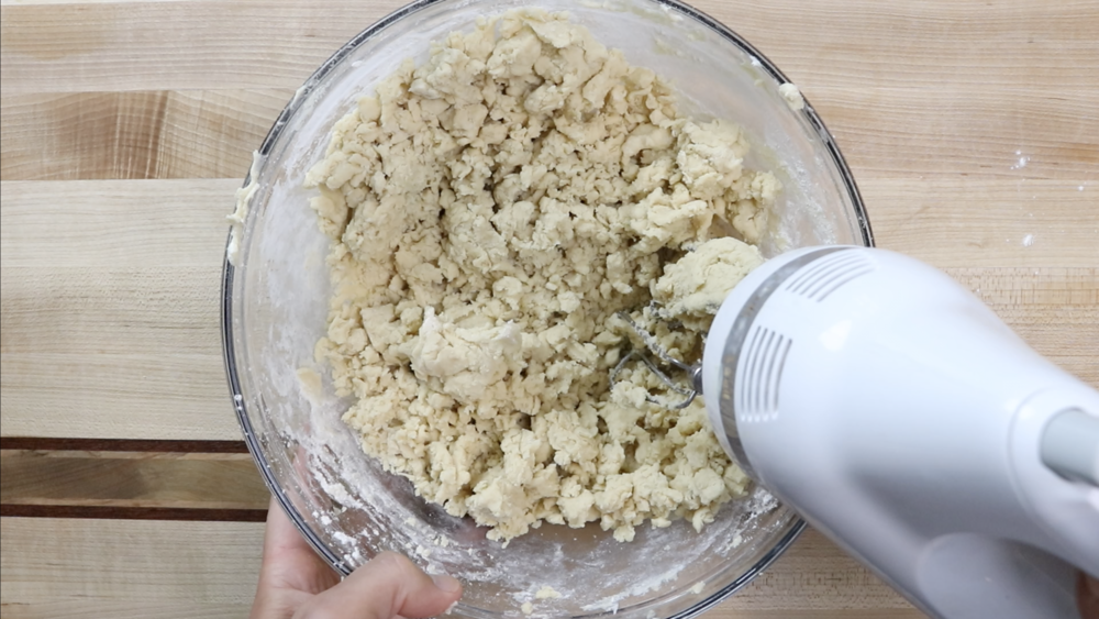5. With mixer on low speed, slowly add flour mixture to wet ingredients until completely incorporated. The dough will be dry and should barely hold together. -