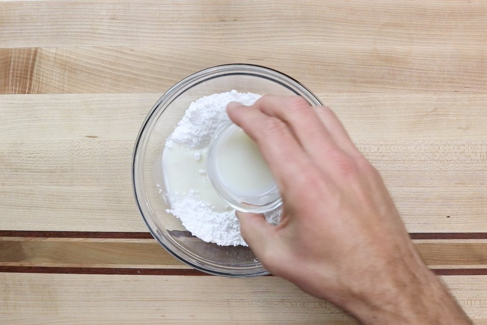 1.. Add powdered sugar to a medium bowl. Slowly add the milk until mixture is smooth and there are no lumps. -