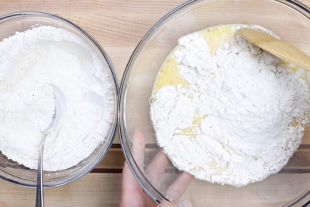 3. Slowly add the flour and mix with a large spoon or the paddle attachment for your mixer. The dough will be very sticky. -