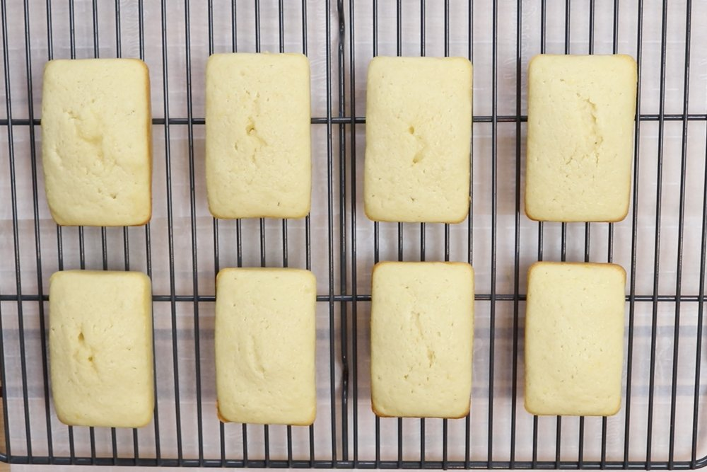 11. Remove from oven and let cool in pan for 5 minutes before releasing. Let loaves finish cooling on a wire rack before decorating. Start making icing. -