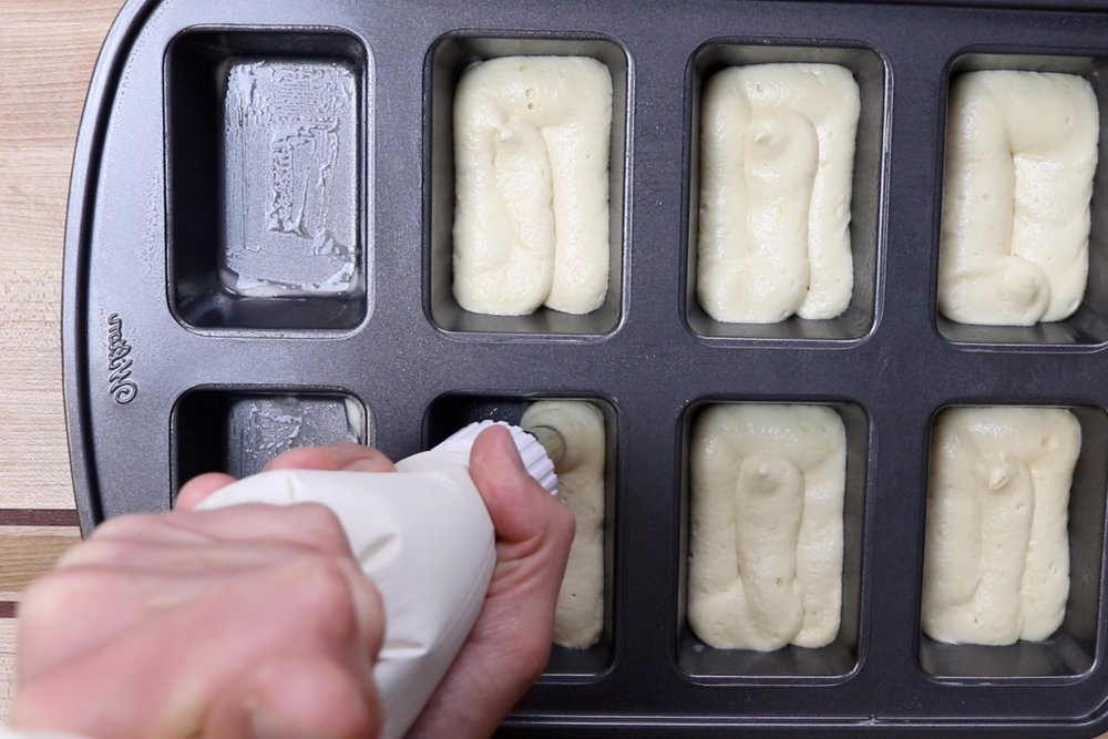 9. Spoon or pipe mixture into the greased mini-loaf pan. Filling loaves about 1/3 full. -