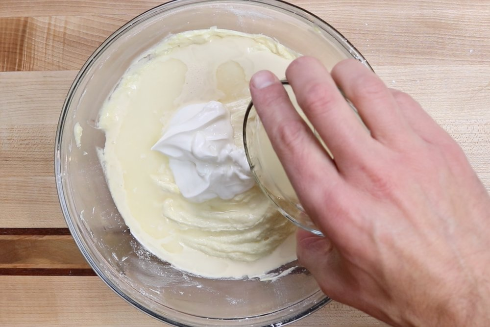 7. Stir in the milk, sour cream and lemon juice. Mix until combined. -