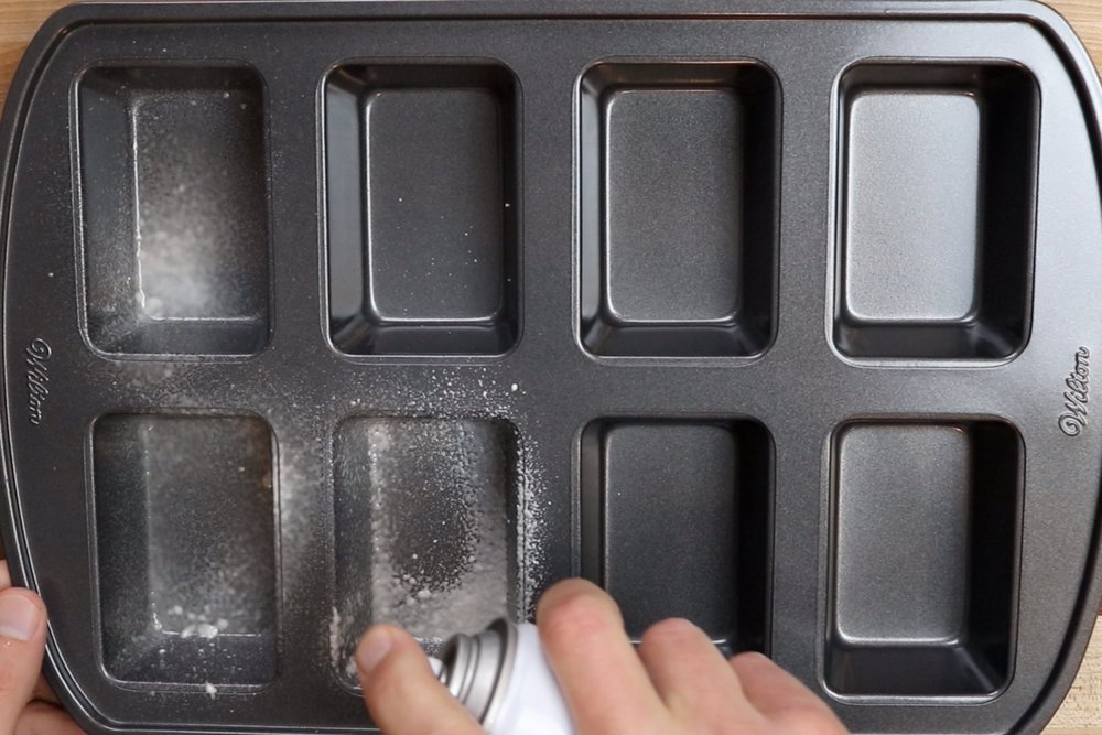 1. Pre-heat oven to 350 degrees and grease a 8 count mini-loaf pan. -
