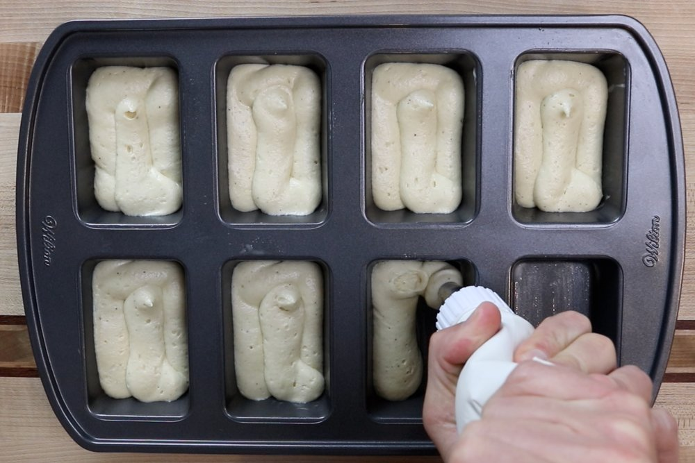 11. Spoon or pipe mixture into the greased mini-loaf pan filling. -
