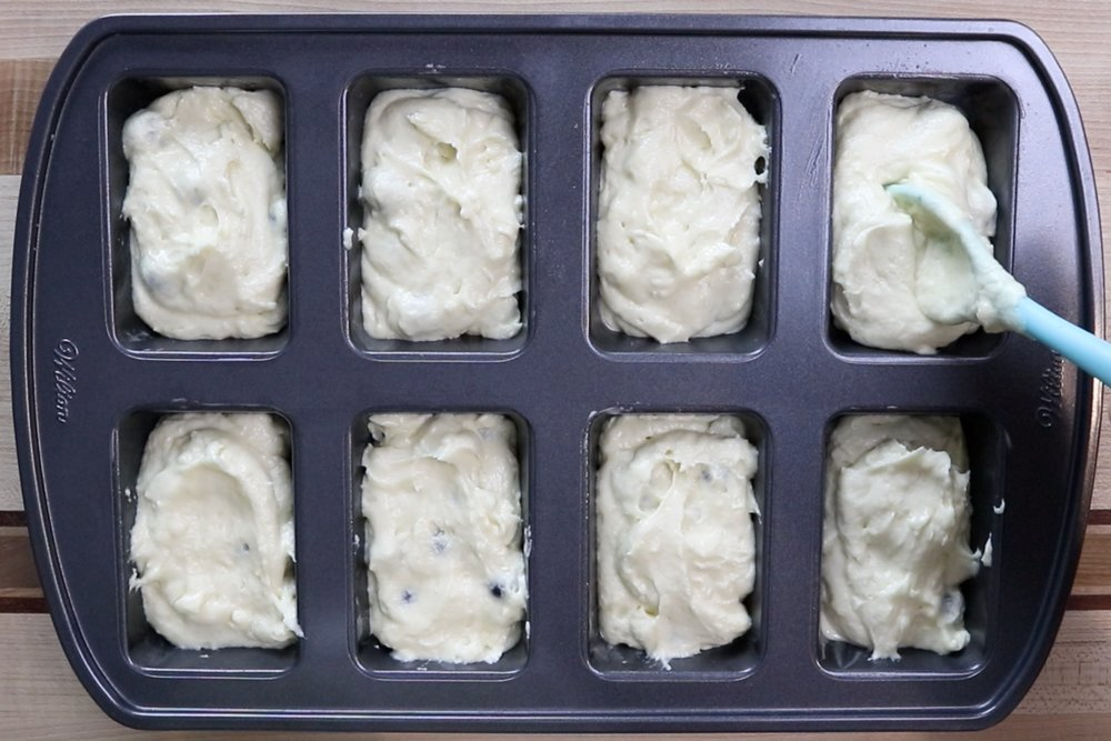 13. Spoon mixture into the greased mini-loaf pan. Filling loaves about 1/2 full. -
