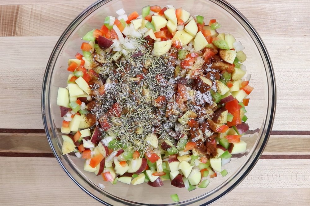 3. Add olive oil and spices to the vegetables and mix until all pieces are coated. -