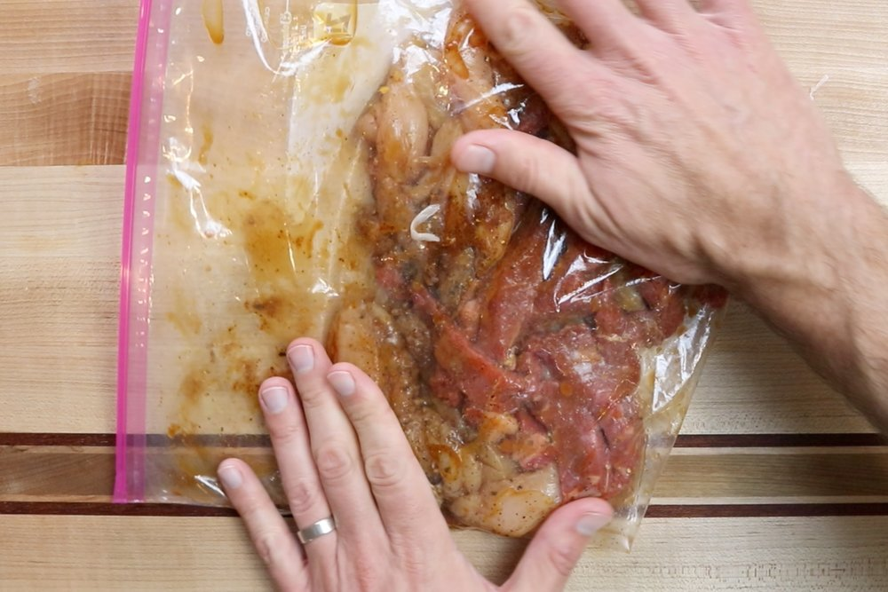 5. Close the bag and massage until all pieces are coated. Set aside in refrigerator until ready to use. -