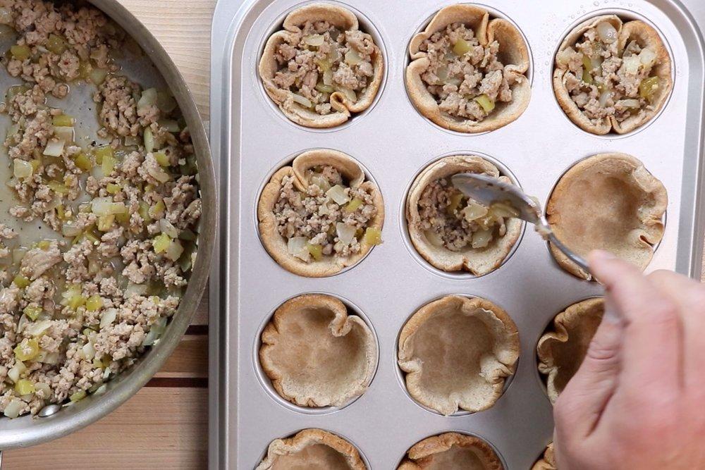 7. Divide turkey mixture evenly between the bun cups. -