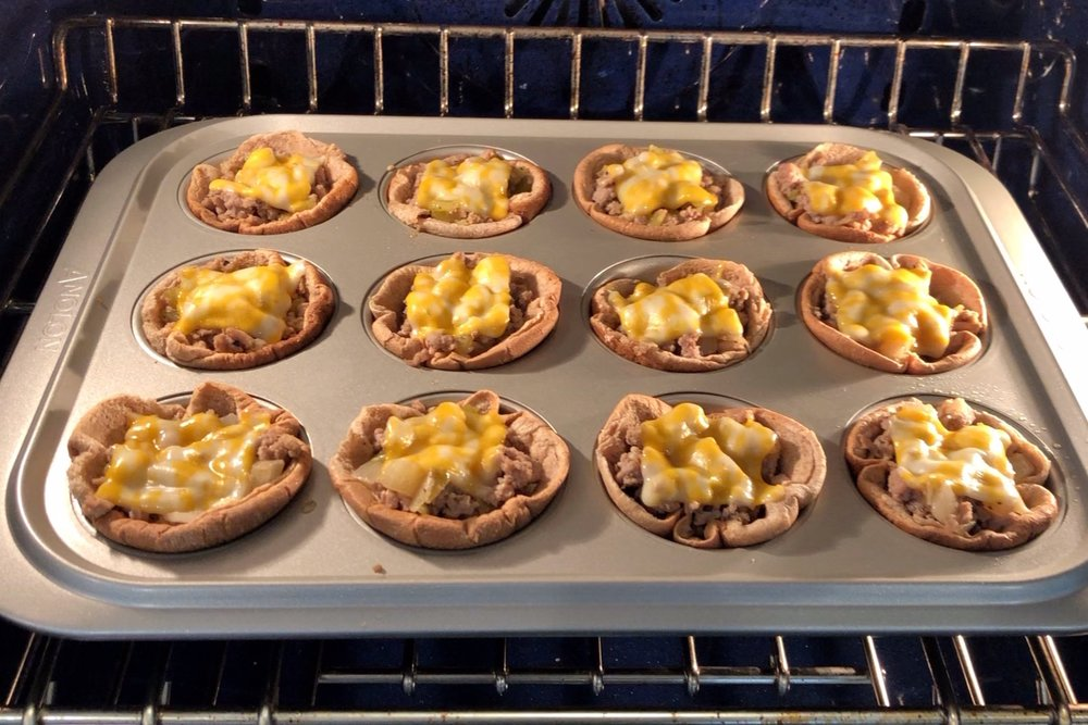 9. Cook in the oven for 10 minutes or until buns begin to brown and cheese is completely melted. -