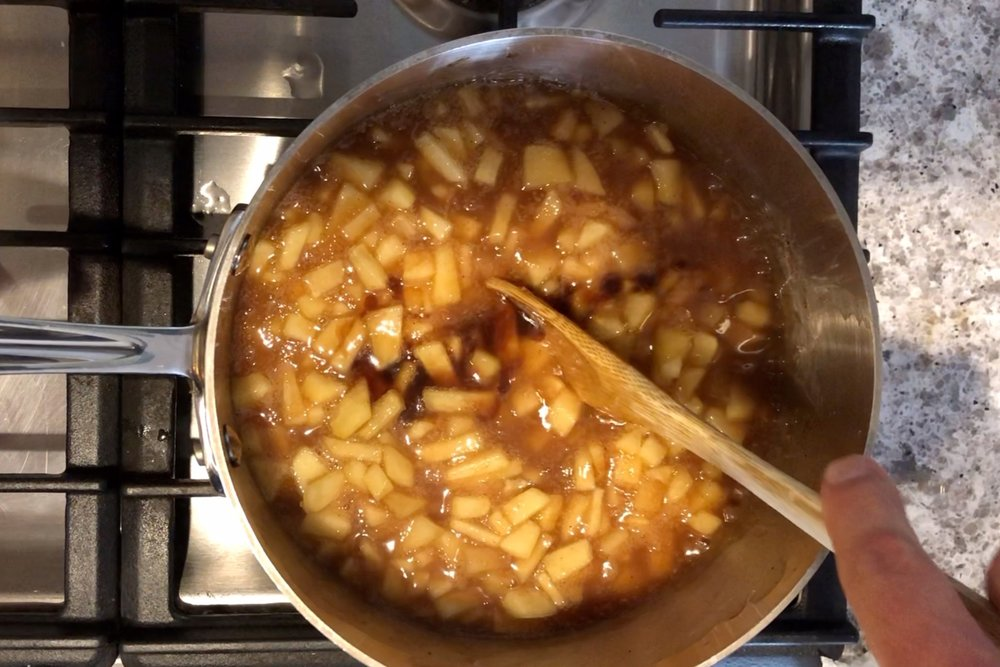 6. Remove from heat. Stir in vanilla and set aside to cool. -