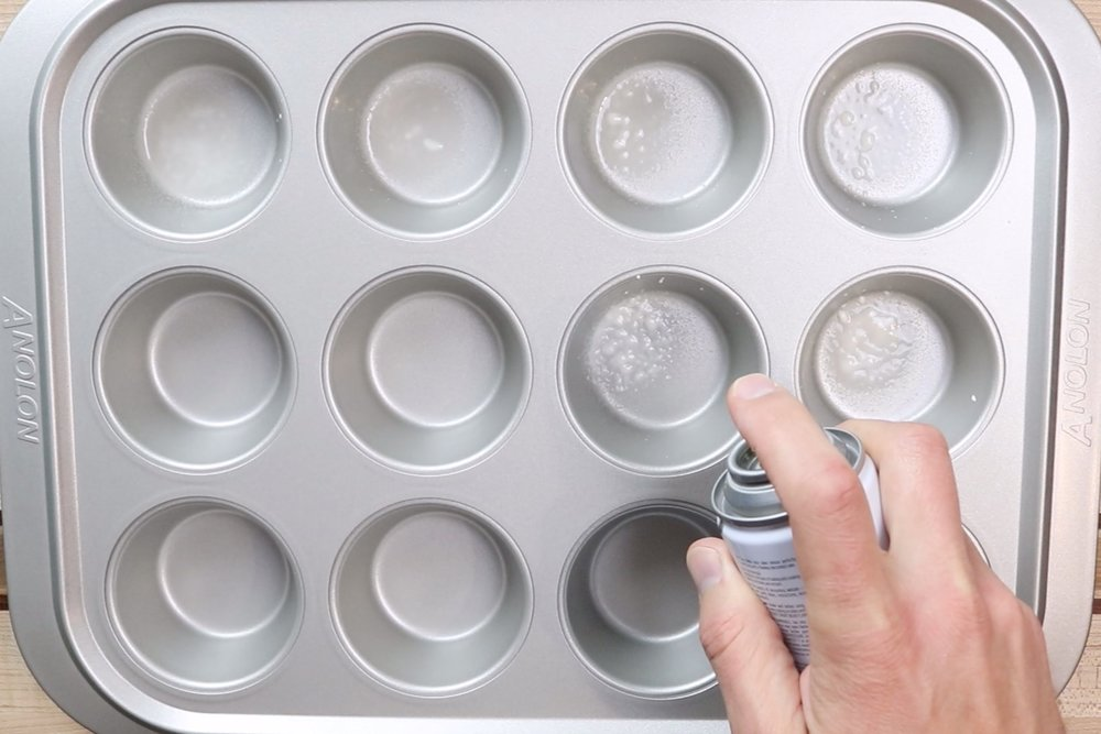 7.  Pre-heat oven to 400 degrees and grease a 12-count muffin tin. -