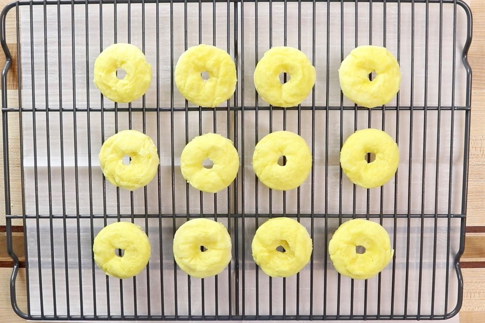 14.  Remove from oven and let cool for 5 minutes before removing from donut pan to let cool on a wire rack.Let cool completely on rack before adding the glaze. -