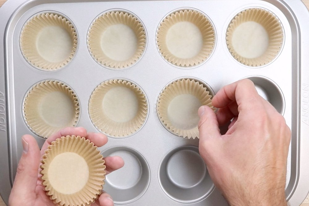 1. Pre-heat oven to 350 degrees and put baking cups in a 12-count muffin tin. -