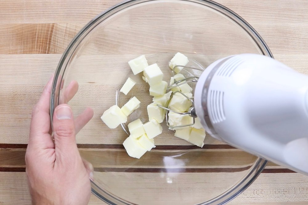 3. Add softened butter to a large bowl or the bowl of a stand mixer. Beat until smooth. -