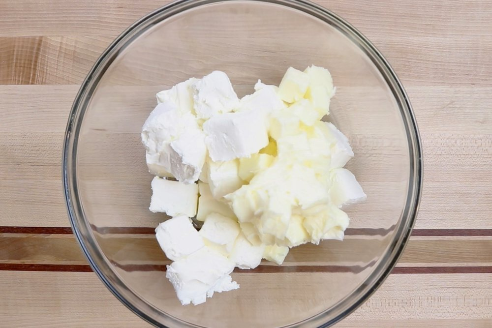 1.  Place butter and cream cheese in a large mixing bowl and beat until smooth. -
