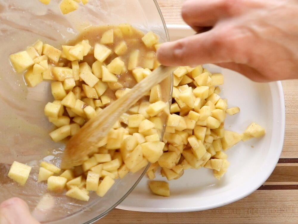 5.  Evenly spread the apple mixture into the casserole dish.   -