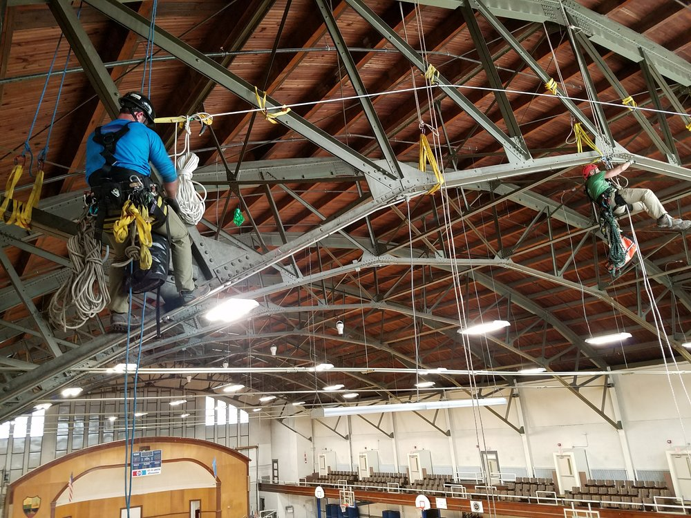 SATS' technicians replacing sprinkler heads in a historic gymnasium. Using our teams allowed for the historic site to stay open for business as usual.