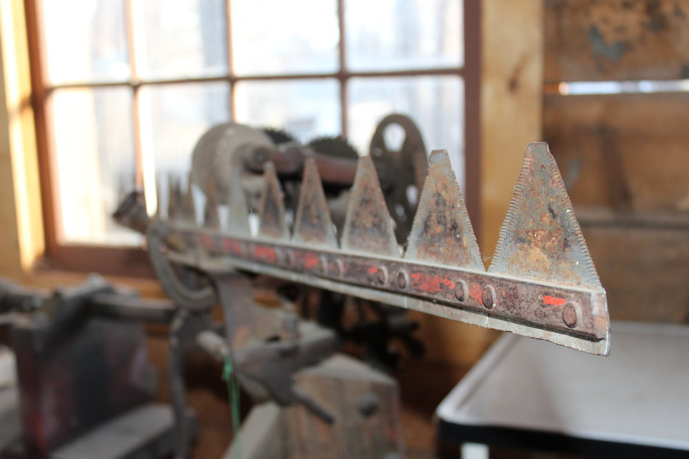 This foot-powered sickle mover sharpener can be found in our blacksmith's shop/tool shed.