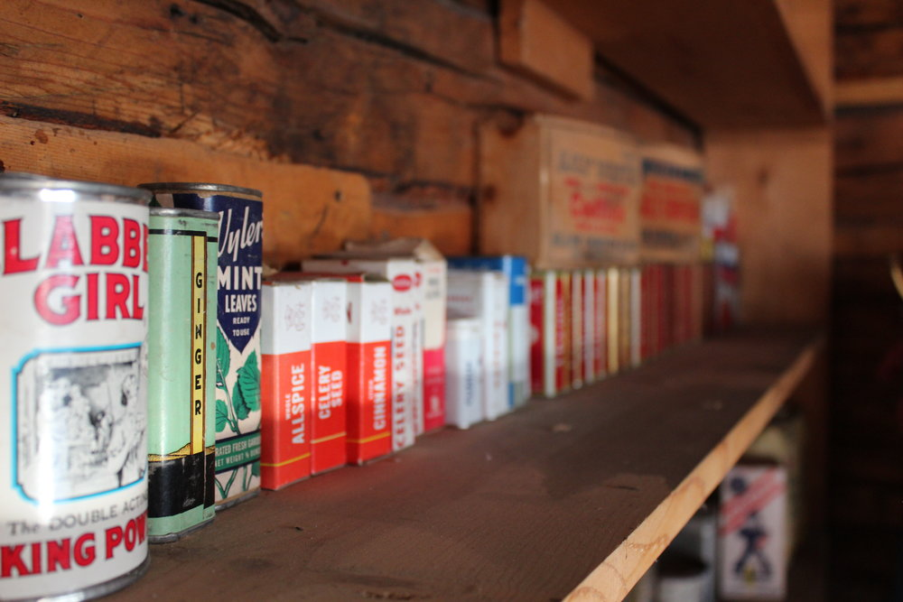 A variety of items line the shelves of the mercantile.