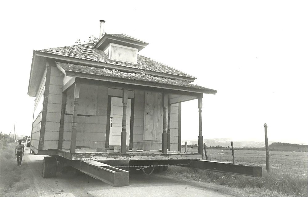 Austin Schoolhouse - The Austin Schoolhouse, which now resides at SHP, was used as the main building for the Rifle Historical Park for a time before they moved to their current location. Here it is pictured being transported via truck.